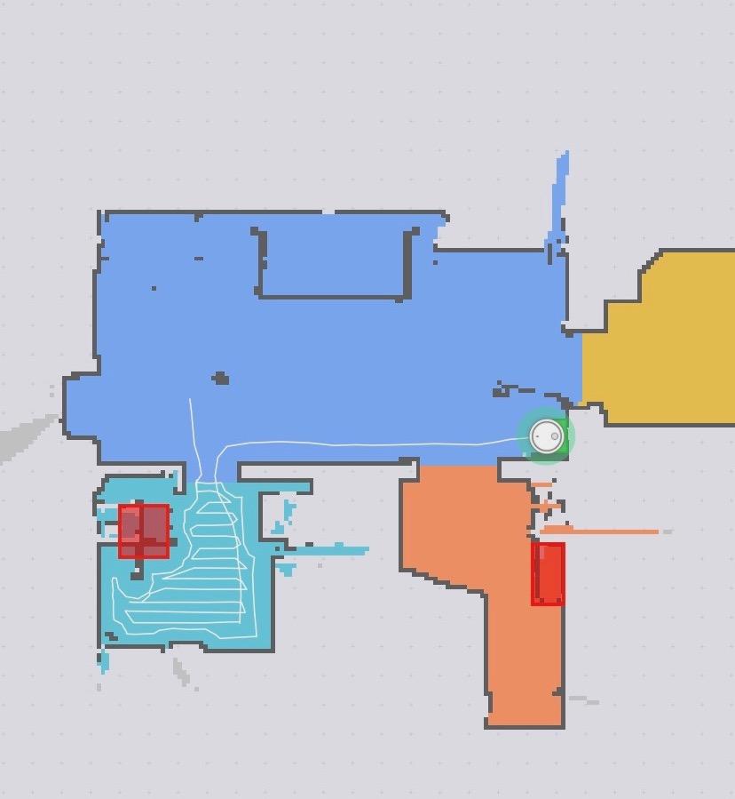 Участки, запрещенные для уборки в приложении Mi Home (выделены красным).